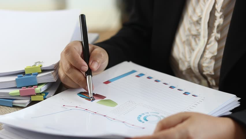 Policy and Plan Analyst are analyzing data from graphs in order to improve their performance. Business and education concept. Royalty-Free Stock Footage #1019561584