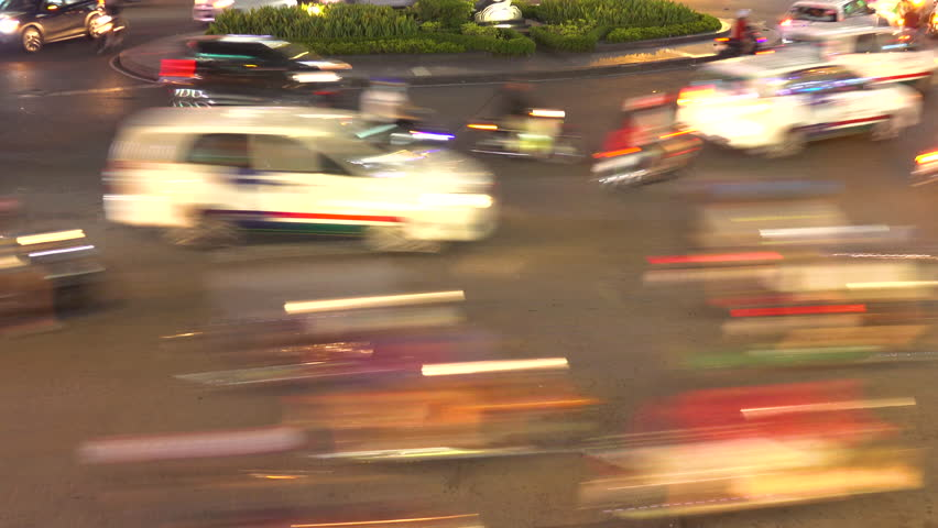 HO CHI MINH CITY, VIETNAM, MARCH 2017 – TIMELAPSE: People drive their cars and ride bikes through a big square in large Vietnamese city. Cool view of colorful streets of Ho Chi Minh on a busy night. | Shutterstock HD Video #1019568202