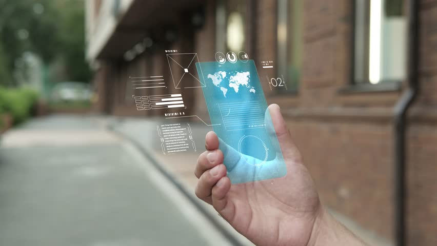 Handsome man using smartphone with futuristic screen. Businessman in the city use new transparent smart phone. World map. Multimedia technology. Future is now. Blue screen | Shutterstock HD Video #1019581456