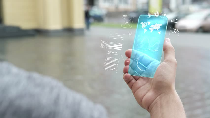 Handsome man using smartphone with futuristic screen. Businessman in the city use new transparent smart phone. World map. Multimedia technology. Future is now. Blue screen | Shutterstock HD Video #1019581474