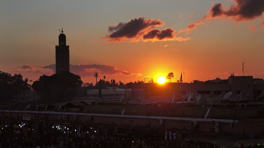 Famous Jemaa el Fna square crowded at sunset, Marrakesh, Morocco, 4k