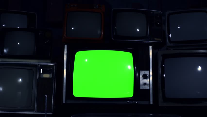 """80s TV Green Screen with Many 80s TVs. Dolly Out. Night Tone. Ready to Replace Green Screen With any Footage or Picture you Want. You Can Do it With """"Keying"""" (Chroma Key) Effect in After Effect. 