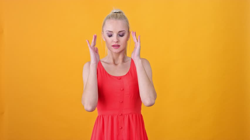 Happy blond woman posing in the studio | Shutterstock HD Video #1019648500