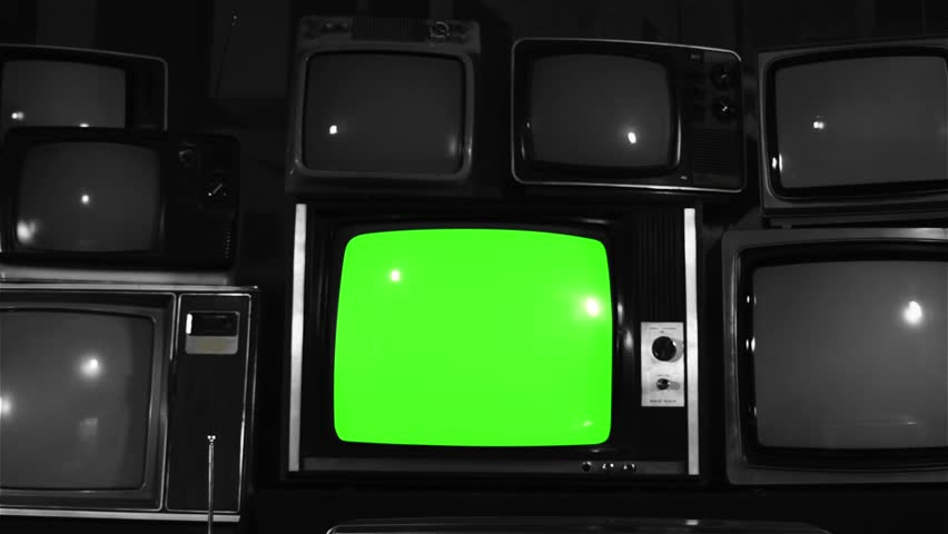 """Old TV Green Screen over 80s TVs. BW Tone. Dolly In Fast. You can Replace Green Screen with the Footage or Picture you Want with """"Keying"""" effect in After Effects (check out tutorials on YouTube).  