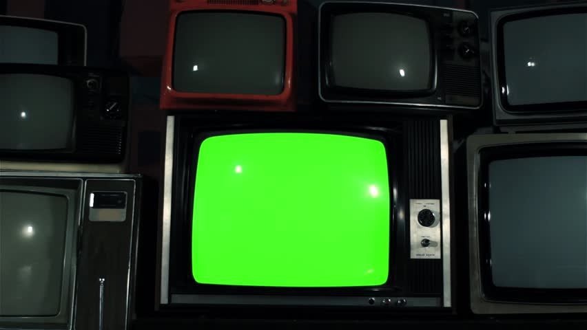 """Old TV Green Screen over 80s TVs. Dolly Out. Iron Tone. You can Replace Green Screen with the Footage or Picture you Want with """"Keying"""" effect in After Effects (check out tutorials on YouTube).  