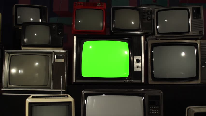"Old TV Green Screen over 80s TVs. Dolly In Fast. You can Replace Green Screen with the Footage or Picture you Want with ""Keying"" effect in After Effects (check out tutorials on YouTube).  