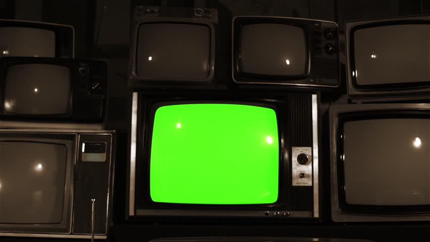 "Old TV Green Screen over 80s Tvs. Sepia. Dolly Out. You can Replace Green Screen with the Footage or Picture you Want with ""Keying"" effect in After Effects (check out tutorials on YouTube).  