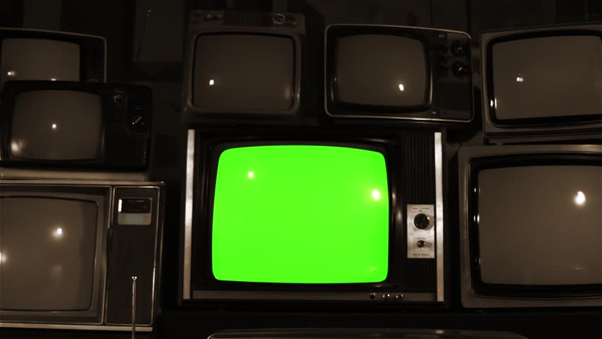 """Retro TV Green Screen over Many TVs. Dolly Out. Sepia Tone. Ready to Replace Green Screen With any Footage or Picture you Want. You Can Do it With """"Keying"""" (Chroma Key) Effect. 