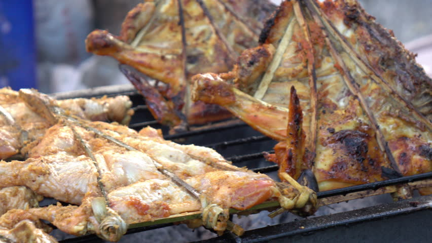 Grilled chicken on chacoal stove   Shutterstock HD Video #1019700505