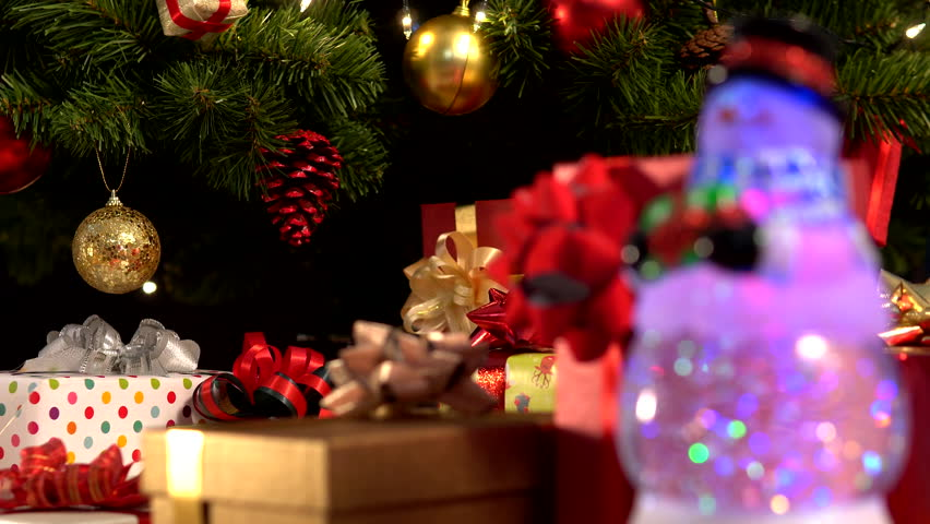 Snowman with Christmas gift near fireplace | Shutterstock HD Video #1019713831