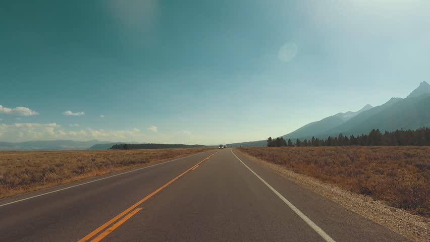 Driving a Car through Grand Teton park, back light, Point of View - Mounted 2.7k Ultra HD footage | Shutterstock HD Video #1019719942