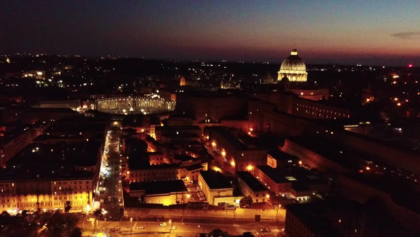 Aerial drone night video of Saint Peter's square, world's largest church - Papal Basilica of St. Peter's, Vatican - an elliptical esplanade created in the mid seventeenth century, Rome, Italy | Shutterstock HD Video #1019741836