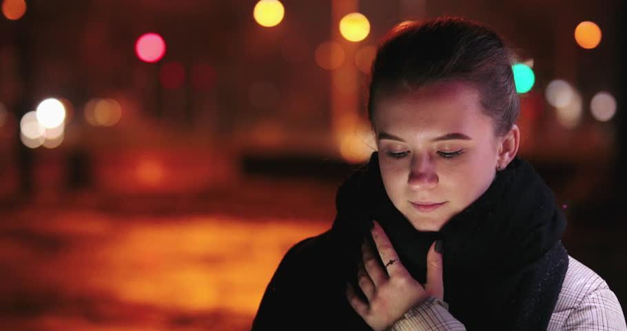 Beautiful girl watch at her phone on night street | Shutterstock HD Video #1019751247