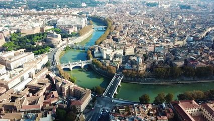 Aerial drone video of iconic and beautiful Castel Sant' Angelo next of Tiber river in the heart of Vatican city in Rome, Italy