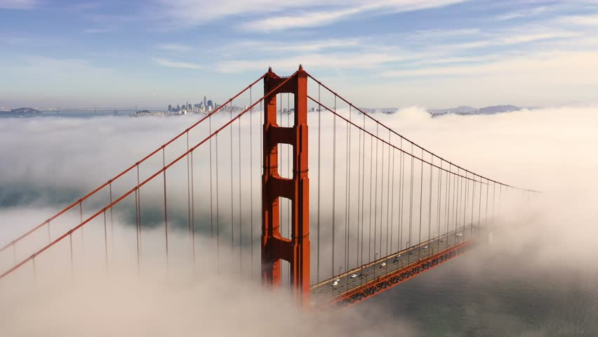 San Francisco Golden Gate Bridge Poking Through Fog - Aerial View / Flyover From Helicopter