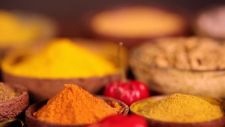 Colorful spices in bowl background  | Shutterstock HD Video #1019798299