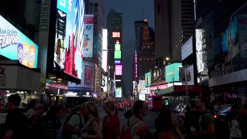 Manhattan, new york / United States - 08 08 2018: Crowd crossing the street in the early evening in Times Square. | Shutterstock HD Video #1019802655