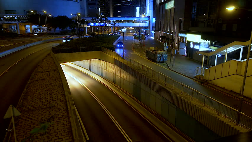 Busy traffic across the main road at rush hour Hong Kong. Nightlife of fast speed metropolis. Cityscape timelapse at night.   Shutterstock HD Video #1019844976