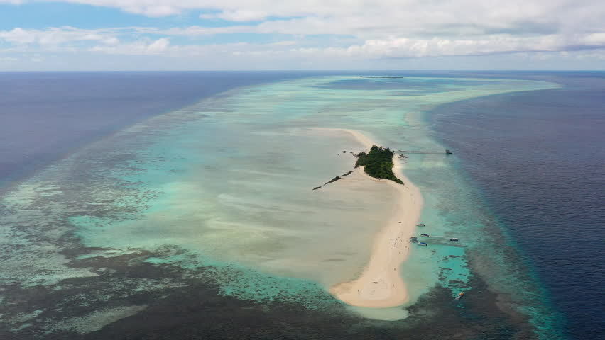 Aerial panoramic view of sandy islet Timba Timba, turquoise crystal clear waters of Celebes Sea, white sand beaches and coral reefs  - landscape panorama of Borneo island, Malaysia, Pacific Ocean   Shutterstock HD Video #1019847979