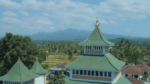 VERTIGO EFFECT Aerial View of Masjid Agung Manonjaya, An Old Mosque and a Cultural Heritage Built in 1834, West Java, Indonesia