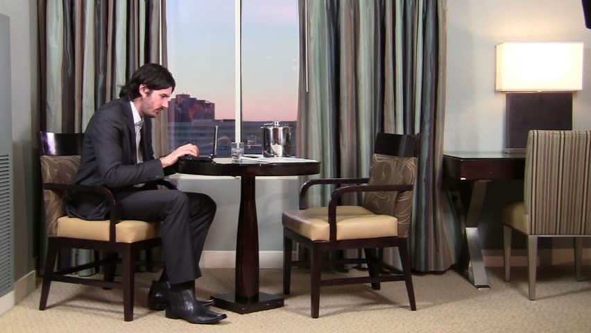 Businessman works on laptop in hotel room - HD | Shutterstock HD Video #1019881
