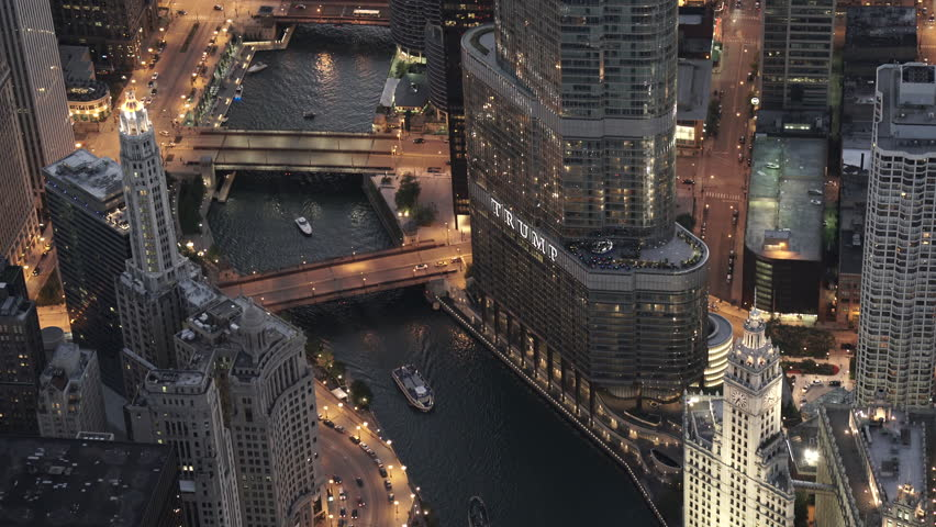 Chicago Circa-2015, telephoto aerial view of the Chicago River with all bridges in view tilting down the Trump International Hotel & Tower, with boats in the river at dusk