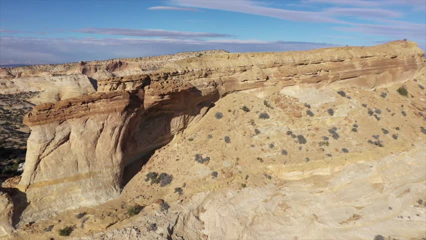 Aerial view of natural arch in Utah desert | Shutterstock HD Video #1019973604