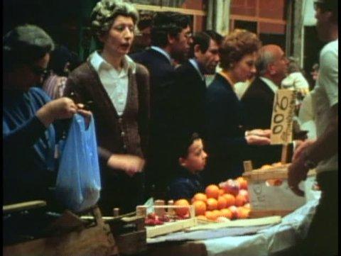 VENICE, ITALY, 1974, Woman shopping, medium shot, buying fruit