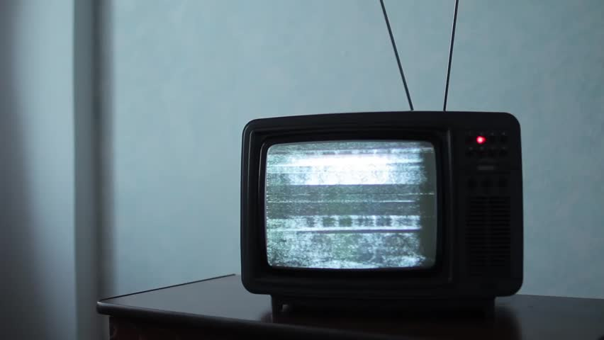 Static noise from an old small TV | Shutterstock HD Video #1020000211
