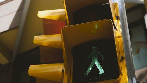 Traffic light. Yellow traffic light with green light