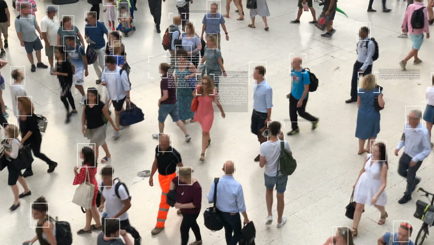 High view of commuters walking. Facial recognition interface showing personal data for each person. Surveillance concept. Artificial intelligence. Deep learning.