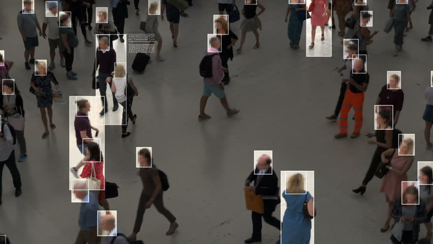 High view of commuters walking. Facial recognition interface showing personal data for each person. Surveillance concept. Artificial intelligence. Deep learning. | Shutterstock HD Video #1020030871