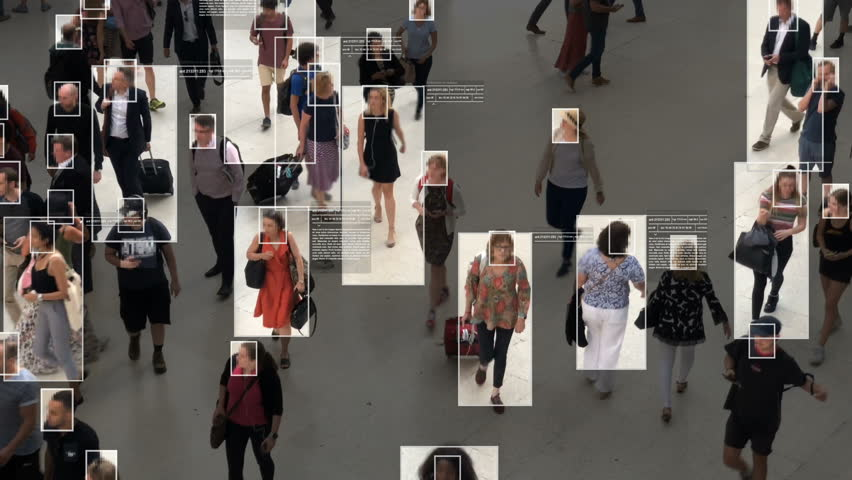 High view of commuters walking. Facial recognition interface showing personal data for each person. Surveillance concept. Artificial intelligence. Deep learning. Royalty-Free Stock Footage #1020030874