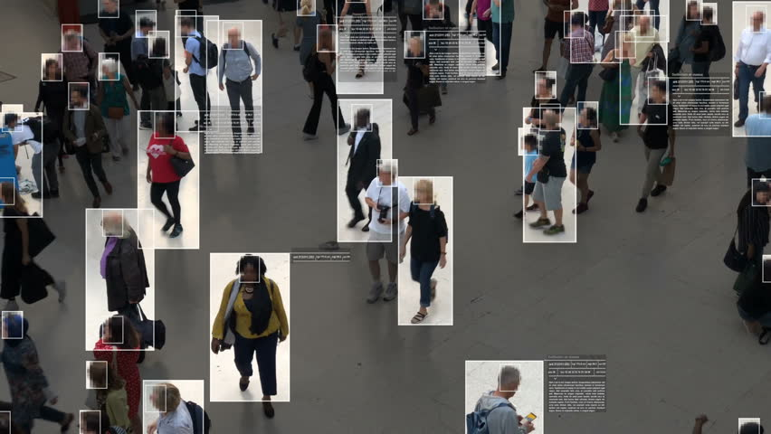 High view of commuters walking. Facial recognition interface showing personal data for each person. Surveillance concept. Artificial intelligence. Deep learning. | Shutterstock HD Video #1020030877