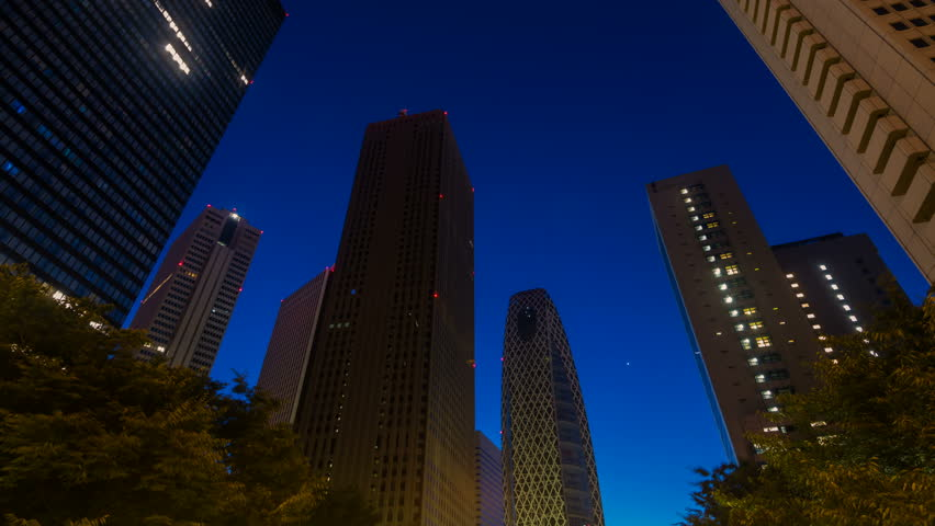 Timelapse low angle shot with tilt up motion of downtown Shinjuku skyline in Tokyo at dawn | Shutterstock HD Video #1020036034