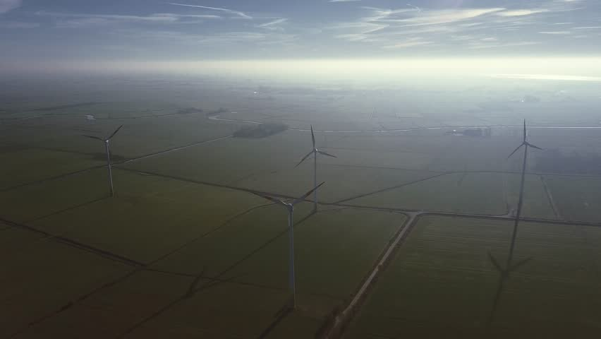 Windmill. Aerial shoot. Wind farm power station in Europe produce renewable sustainable energy. Wind Turbines aerial view taken with a drone. Wind power technology. | Shutterstock HD Video #1020070201