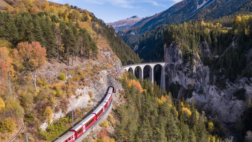 Following a train on the viaduct Landwasser in Swiss mountains during the autumn. Filmed with the Inspire 2 drone in 5.2k RAW resolution and downscaled to 4k.