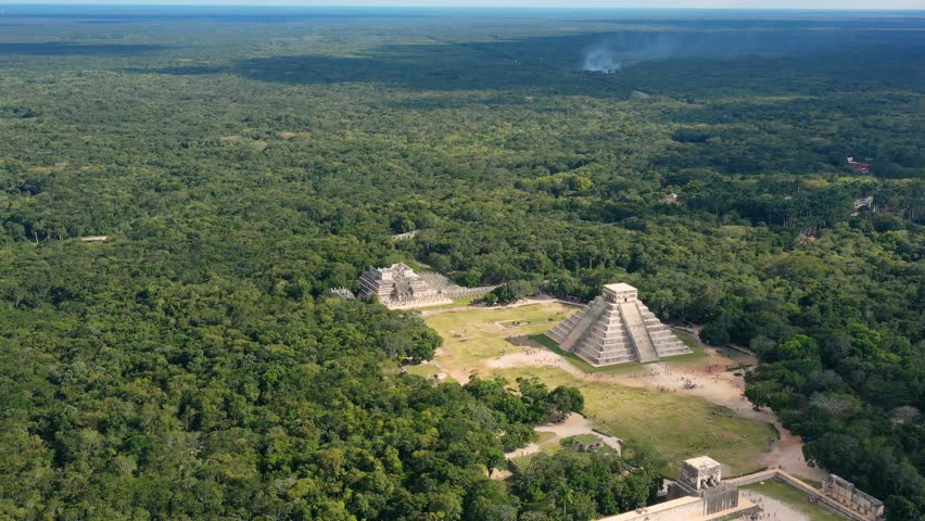 Aerial view of ancient Mayan city of Chichen Itza, famous mesoamerican pyramid El Castillo (Temple of Kukulkan) - landscape panorama of Yucatan Peninsula from above, Mexico, North America, 4k UHD