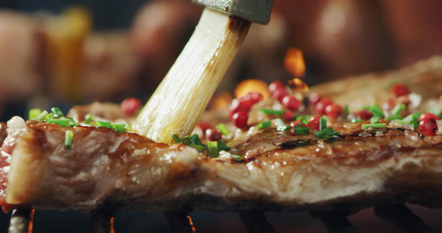 Closeup of meat on the grill of a barbeque cooking on a high flame. Concept: Friends, holiday, tradition, relax | Shutterstock HD Video #1020089626