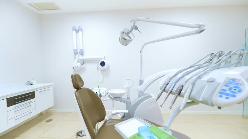 Clean white modern dentist cabinet. Spacious room with a dental radiography on a screen. Cinematic effect with slow motion | Shutterstock HD Video #1020103477