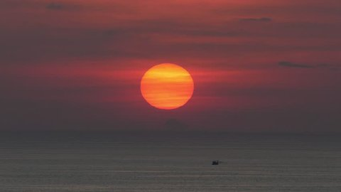 Sunset is a fishing boat running under the sun.