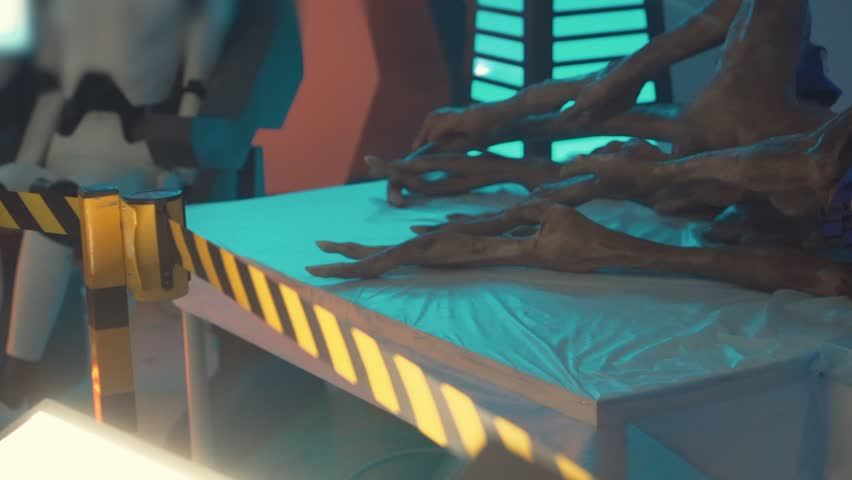 Toliatty, Samarkaya obl. / Russia - 11 24 2018: Scarecrow Gray alien body exists on the operating table behind the barrier medical operating future