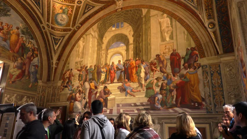 Rome, Italy - 02.01.2018: A woman takes a photo of the frescoes of the Italian Renaissance artist Raphael inside the Vatican Museum. It is called The School of Athens (Italian: Scuola di Atene)