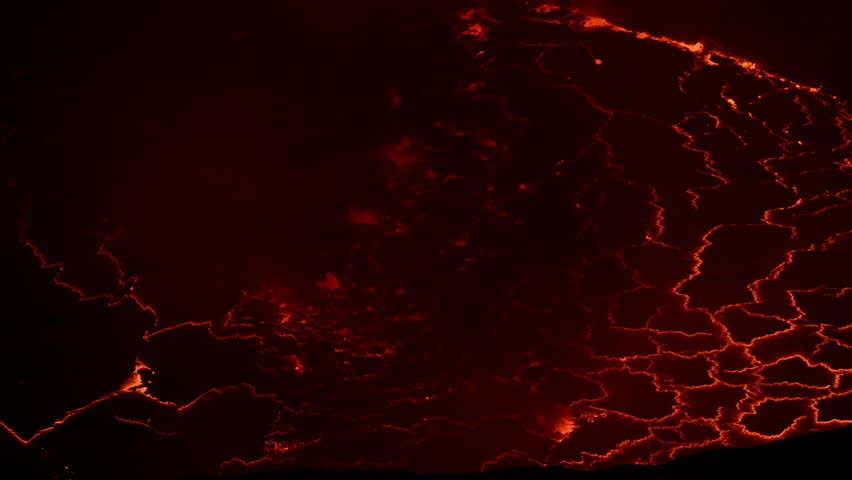 View into the liquid lava lake inside the crater of Nyiragongo volcano – this is the largest lava lake on earth, it is located in the Virunga Mountains, North Kivu province, DR Congo.  | Shutterstock HD Video #1020165463