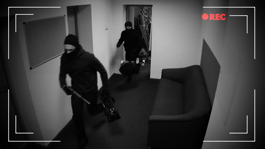 Masked thieves running off with begs of money, shooting in surveillance camera   Shutterstock HD Video #1020248086