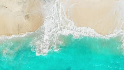 Tropical beach with turquoise ocean water and waves, aerial view. Top view of paradise island