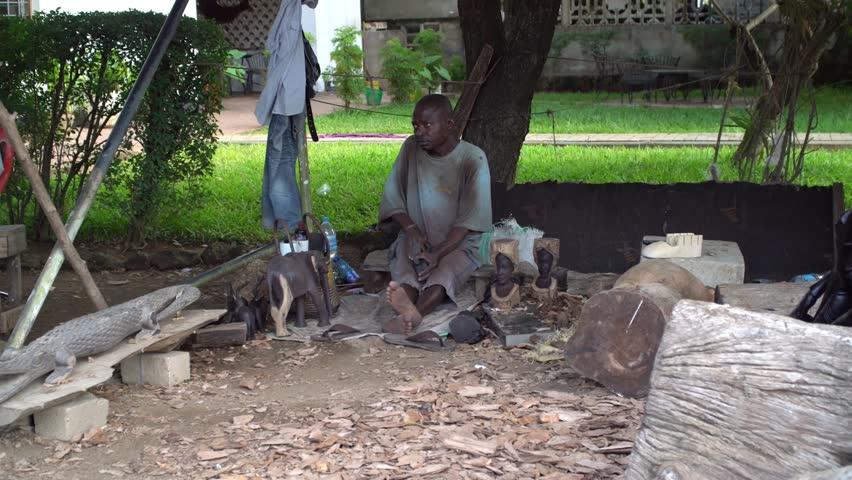 Dar es Salaam, Tanzania, circa January 2018: African craftsman working with wood | Shutterstock HD Video #1020280234
