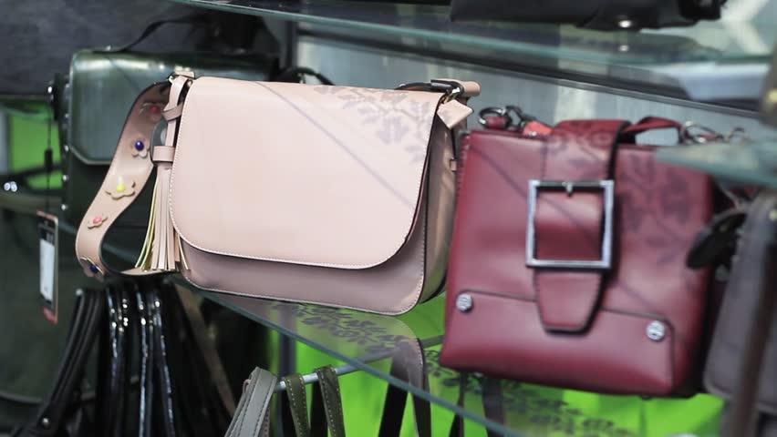 Female hands chooses a female handbag in the store   Shutterstock HD Video #1020280822