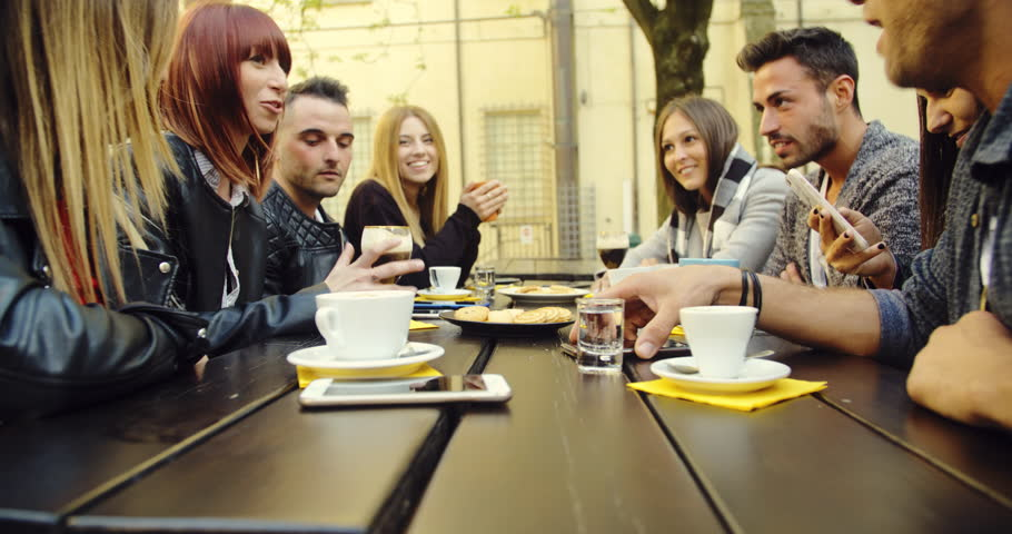 large group of friends in an outdoor cafeteria #1020281689