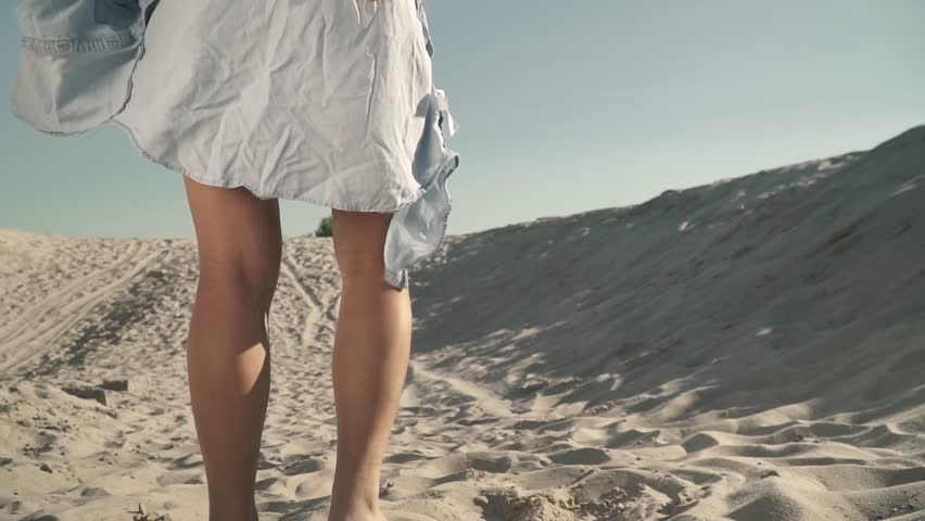 Young sexy woman at the beach Hot woman with long dark hair slowly sits on the sand   Shutterstock HD Video #1020282886